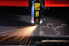 a close up of a laser cutting mild steel